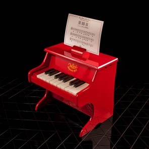 Rotes Spielzeugpiano